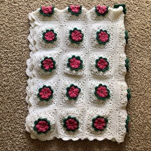 Crocheted granny square blanked w/ raised flowers